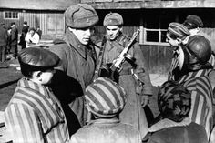 Soviet soldiers speak with children at Auschwitz following the liberation of the concentration camp. In mid-January 1945,