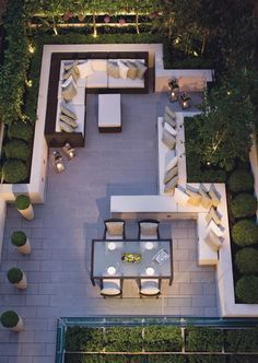 aerial view | indoor outdoor backyard design | outdoor sitting room and dining room - perfectly balanced | storage for tools etc under the benches | brown modern wicker lounge seating | sectional sofa