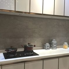 A Kitchen Splashback Featuring Persian Grey Stone Effect Large Format Porcelain Tiles Kitchen