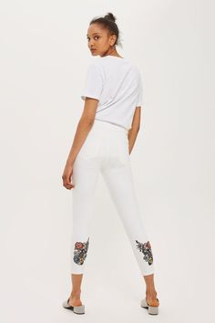 "Accent denim is a trend to adopt this season. This embroidered 28"" Jamie jean is one of our favourites. Embellished in subtle floral embroidery at rear hems, these cropped leg jeans in white are the perfect match to a graphic t-shirt."