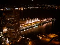 Night shot from the Harbour Centre Tower in downtown Vancouver, British Columbia, Canada. Its lookout with its 360 degree viewing deck offers fantastic views of the city. This view shows Canada Place, Burrad Inlet and North Vancouver.