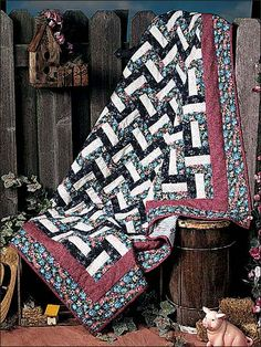 "This Rail Fence design is easy to make, and the resulting quilt is strikingly beautiful. Size: 57"" x 66""; strip-piecing. Skill Level: Easy"