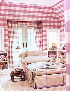 This reading room in between bedrooms (quite the luxury) has been covered in a lavender plaid by Kathryn M. Ireland.  An over-sized chaise has been given the same accent color in the form of fabric tape.  The faux shearling pillow makes this a spot you and the kids won't want to leave.  www.bilhuber.com