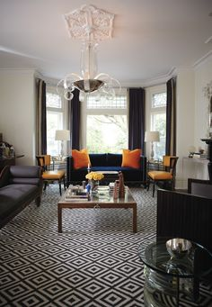 Orange accents and gorgeous geometric rug
