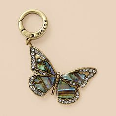 Butterfly Charm $ 22    Piece your story together with this delicate brass ox-tone and abalone butterfly charm. Clear crystal pave details surrounding the wings add a hint of sparkle.