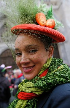. A woman sports colorful carrots on her hat and a scarf resembling salad greens during the annual Easter parade along Fifth Avenue near St. Patrick\'s Cathedral, Sunday, March 27, 2016, in New York.  (AP Photo/Kathy Willens)