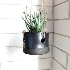 Small hanging black pot.