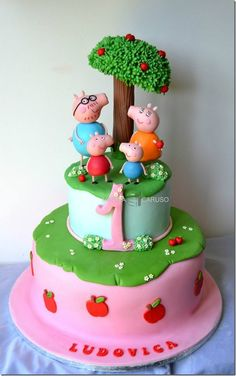 Peppa Pig First Birthday Cake was made by Marzia Caruso Cake Design.  Marzia's figures of Peppa Pig, George Pig, Daddy Pig, and Mummy Pig.