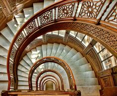 "Oriel Staircase © Leslie McLain (""Architect John Root designed an iron staircase that winds down from floor 12 to 2 in the historic Rookery Building. Photographing the staircase is difficult as the building limits access to the staircase and tripods are not allowed at all."")"