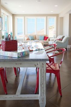 Beach house, view 2: Sand grey walls, neutral furniture, turquoise and red accents