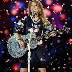 Taylor Swift's first sold-out NFL stadium show. EVER. (And we kind of love what she's wearing.)