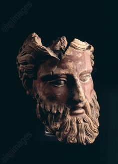 Etruscan ~ Fragment of a male head ~ Classical period ~ beginning of the 4th century BC ~ Ornament from a gable beam ~ Terracotta ~ Found: Orvieto, Temple in the Via San Leonardo.