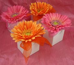 Favor box (Would use small takeout box w/ shower label on front). Top w/ daisy hair clip. Fill w/ candy.
