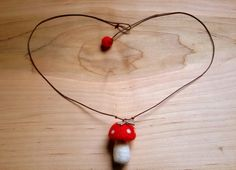 A whimsical and unique mushroom necklace with a dragonfly charm. Perfect for the birthday boy/girl or their sister/brother. Great as a present from the tooth fairy or an enchanted Christmas present. This necklace is just perfect for girls and boys alike. This would also make a great stocking stuffer.  The mushroom is about 1.5tall handmade from 100% pure wool needle felted tightly.  My felted gnomes and mushrooms are meant to be gently handled by older children and adults. Not suitable for…