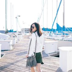 Michelle (@runwayonthego) Biker jacket with faux suede dress, and fringe bucket bag. #ootd #wiw #yachtchic #lotd #fashionblogger