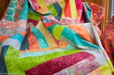 Colorful strip quilt.