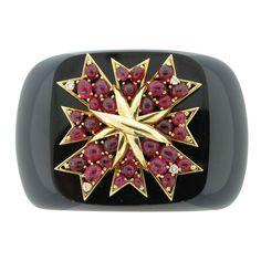 VERDURA Ruby Diamond Onyx Cuff  U.S.A.  2000's  The wide onyx cuff centering upon a sculpted gold plaque, set with cabochon rubies and round diamonds, mounted in gold.  Price  $40,000