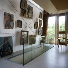 Pictures hung on wire. Dune House and Office | iGNANT.de