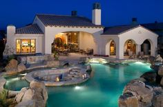 Fire pit surrounded by pool. 40 Fancy Swimming Pools for Your Home