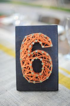 """""""I think this would look really cute as a monogram, too.""""  Fun to do with mini brads and bakers twine."""