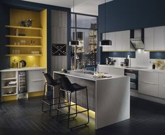 Your builder can repaint walls to introduce on-trend blue into your kitchen. Pair dark midnight blue with bold, yellow accents to create a modern colour scheme that pops. For more inspiration, visit Howdens. Free Kitchen Design, Interior Design Kitchen, Kitchen On A Budget, Home Decor Kitchen, Kitchen Ideas, Kitchen Board, Kitchen Inspiration, Howdens Kitchens, White Kitchens