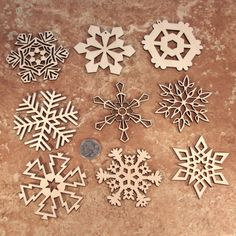 Wooden Laser-Cut Holiday Snowflake Ornaments - 3 Inch Diameter - Set of 9. $20.00, via Etsy.