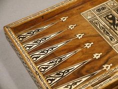"""A Backgammon board. As mentioned in Chapter One: """"The olive-wood board was intricately inlaid with ebony, ivory and mother of pearl. Chess Squares, Magical Room, Backgammon Game, Wood Hinges, Board Games, Game Boards, Diy Games, Pyrography, Decorative Boxes"""