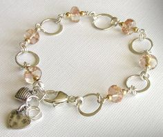 Oregon Sunstone Bracelet in Silver with Gold Filled Accents. $87.00, via Etsy.