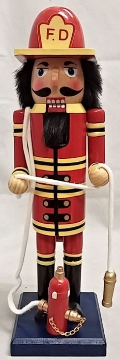 Fireman with Fire Hydrant and Hose Wooden Christmas Nutcracker 14 Inch