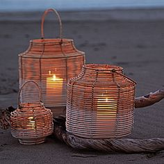 Two-Toned Rattan Lanterns bring a natural element – and a bit of mood lighting – to your table. Woven by hand of natural rattan, detailed to look as though the bottom half was dipped in white paint. A glass hurricane sleeve adds protection from drafts and dripping wax.  Two-Toned Rattan Lanterns #serenaandlily