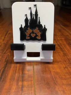 These Disney Phone Stands Will Help You Keep Track Of Your Phone Secondary Color, Primary Colors, Chihuahua Names, Disney Phone Cases, Captain Jack Sparrow, Keep Track, Cinderella Castle, Phone Stand, Disney World Resorts