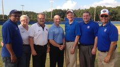 """Congressman Daniel Webster threw out the first pitch at a Winter Garden Squeeze baseball game, during which West Orange elected officials participated in an orange """"squeeze off."""" After the first inning, Oakland Commissioner Joseph McMullen, Ocoee Commissioner Rosemary Wilsen, Windermere Mayor Gary Bruhn, Clermont council member Tim Bates, and Winter Garden Commissioner Robert """"Bobby"""" Olszewski competed to see who could squeeze the most juice into a glass."""