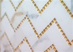 Chevron Marble Mosaics | Calacatta Gold Glass.. Love this tile for my kitchen!