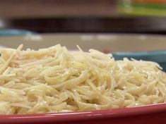 Ree Drummond's fettuccinie alfredo - wow this was amazing! using FRESH PASTA from the refrigerated section was so key - and we did use light cream and that worked great