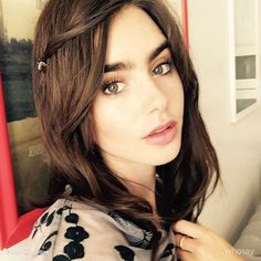 Lily Collins back to brown. Still incredibly beautiful.