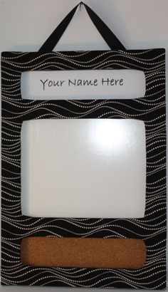 Black and white with splashes of red (poppies).  Cubicle, office or dorm accessories.  Customized name plate section and white board - super cute for outside of your cubicle or office.  Found on Etsy.