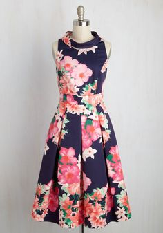 This navy A-line is finesse at its finest, and it has the accents to support such a bold claim! Bolstering its silhouette is a foldover mockneck, essential pockets, and a crisply pleated skirt, giving the style of this floral number so much strength, its brilliance can't be beat.