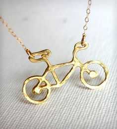 Petite Bike Necklace by Rachel Pfeffer Jewelry on Scoutmob Shoppe. Petite recycle brass bicycle pendant on a 14k gold filled cable chain.