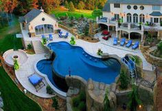 Great use of space in a back yard that is on a hill side. Love the tiered pool, pool house, fire pit and more.