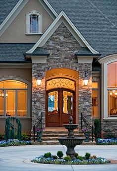 Front entry of the Heatherstone Plan 5016 http://www.dongardner.com/plan_details.aspx?pid=3332 With its masterful architecture and lavish conveniences, The Heatherstone captures the essence of grand living, blending style and grace. #Home #Designs #Craftsman #Door