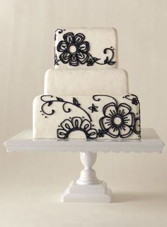 Rebecca Salinas got crafty with this three-tier beauty—the flowers were modeled after a rubber daisy stamp. Navy royal icing took the place of ink. Fondant cake with hand-piped flowers and a fondant-covered base Black White Cakes, Black And White Wedding Cake, White Wedding Cakes, Cake Wedding, Gorgeous Cakes, Pretty Cakes, Cute Cakes, Amazing Cakes, Bolo Floral
