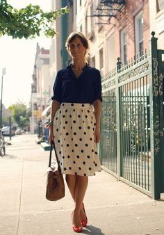 Pretty. Midi polka dot skirt, tucked in, rolled up shirt.