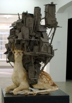 A surprising mix of taxidermy and model houses.