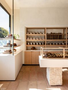Los Angeles studio Commune has used plaster walls, wood built-ins and terracotta tile floors to create a rustic feel inside this bakery in Santa Monica. BreadBlok is a bakery founded by Chloé Charlie Bakery Shop Design, Store Design, Bakery Interior Design, Cafe Design, Design Design, Coffee Club, Coffee Shop, Diet Coffee, Coffee Coffee