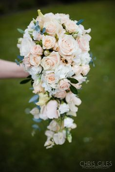 Peach and cream tear drop bouquet by Boutique Blooms Floral Design. Roses, hydrangea, lisianthus and eucalyptus. Surrey wedding at Nonsuch Mansion. Photo from Becky & Ollie collection by Chris Giles Photography
