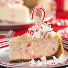 Peppermint Candy Cheesecake Recipe Desserts with graham cracker crumbs, sugar, butter, sour cream, eggs, all-purpose flour, vanilla extract, cream cheese, soften, candy, frozen whip topping, thaw, candy