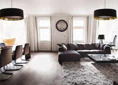 The comfortable and very large Cenova sofa is nicely incorporated in this combined working, living and dining room.