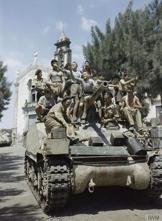 British tankers rolled Italian children. Sicily 1943