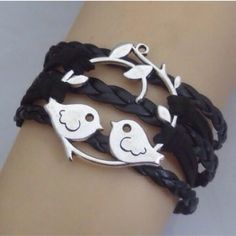 Bird Bracelet Cute bird bracelet on black cords. This has a chain extended and lobster clasp on the back. New in package. Jewelry Bracelets