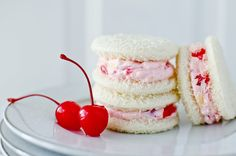 Cherry & Pineapple Tea Sandwiches  ~8oz softened cream cheese,  ½c crushed pineapple-drain well dry w/paper towel,  ¼c maraschino cherries-drain well,pat dry,  2tbsp powdered sugar,  1/2tsp salt, Softened butter, White Bread  ~Whip: cream cheese, salt til fluffy. Fold in fruits~Remove bread crust. Lightly butter 1 side of bread & Spread cream cheese on buttered side, top w/buttered side down. *Spreading butter on forms protective barrier between filling so bread isn't soggy.